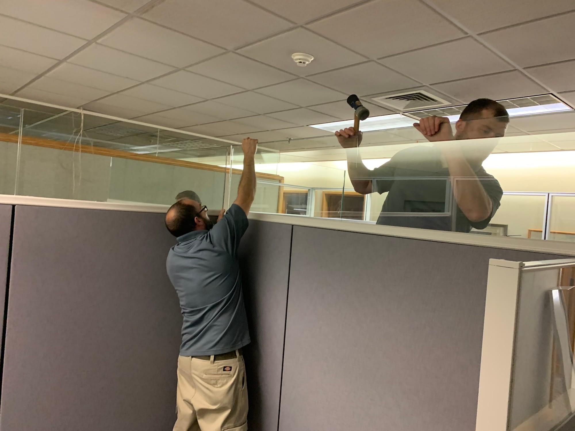 installers assembling workstations