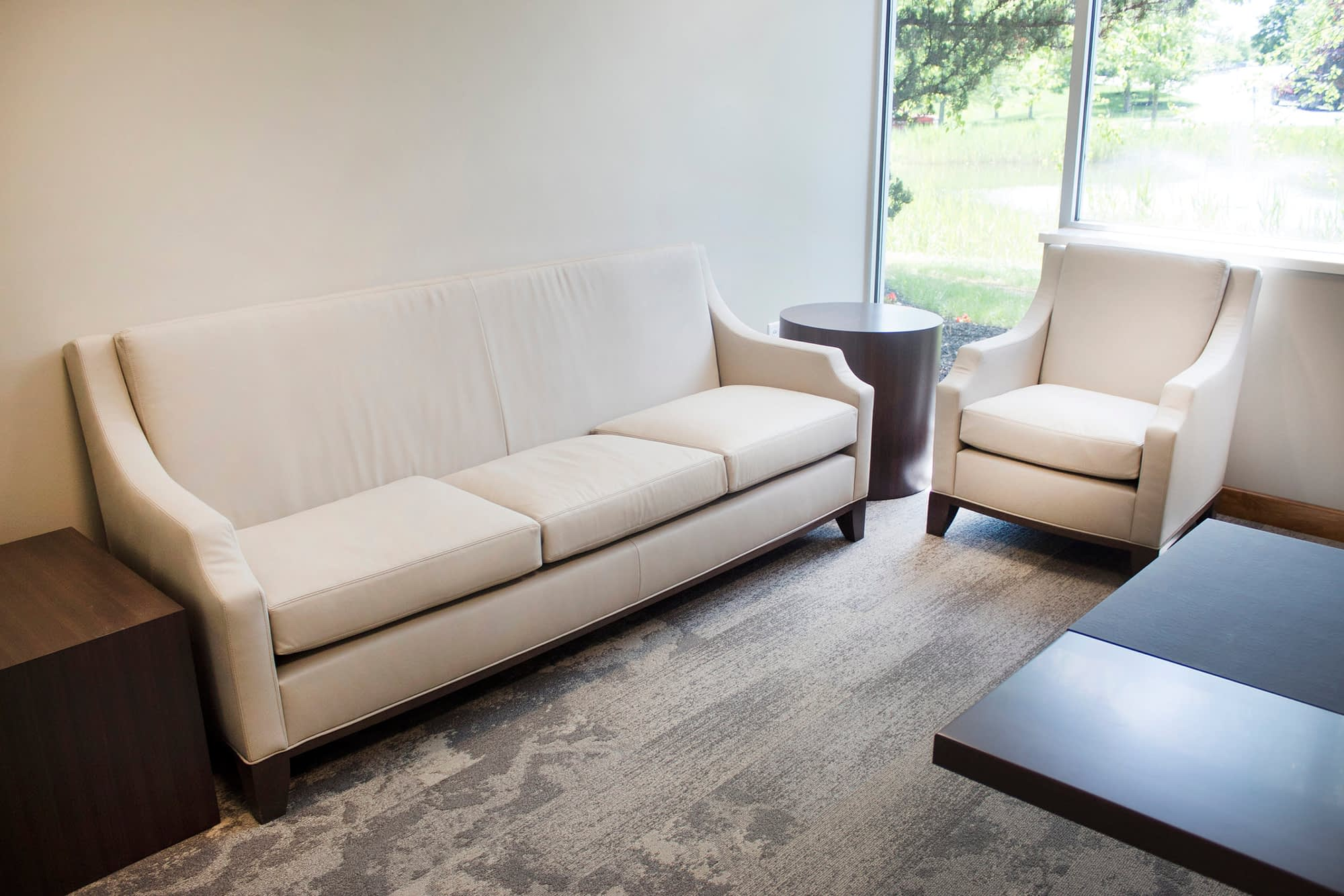 Executive Office with White and Brown Workstation Sofa and Chair