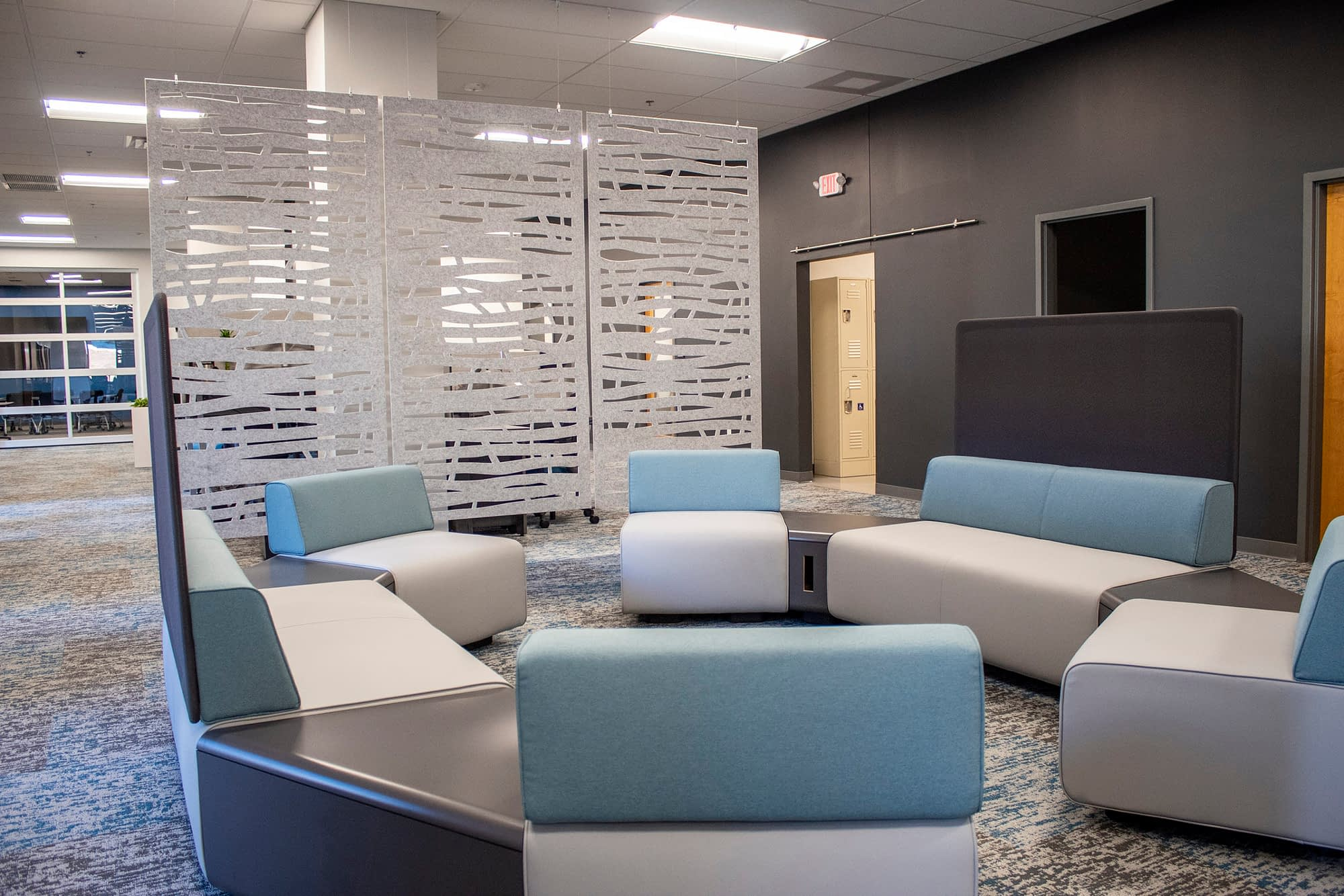 seating area with space divider panels